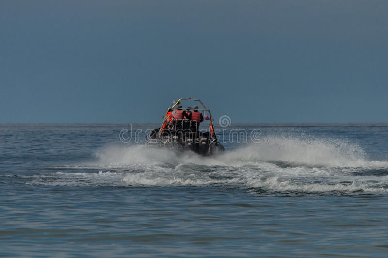 Speed motor boat transporting people on sea.  royalty free stock images