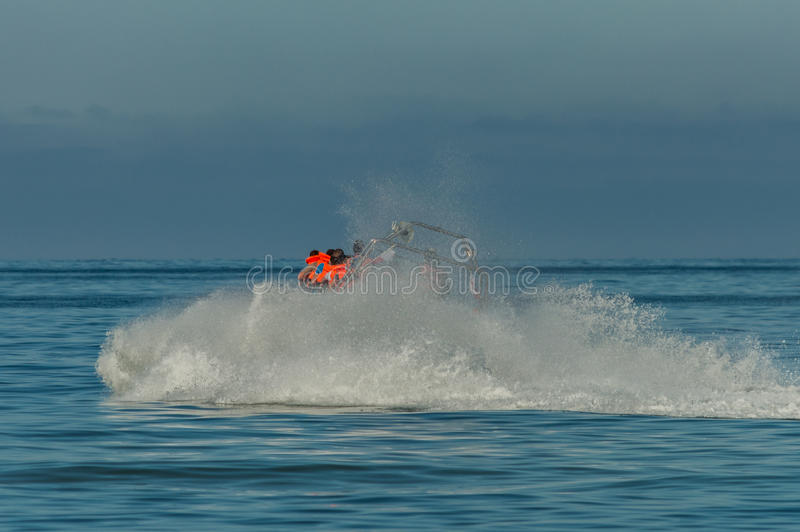 Speed motor boat transporting people on sea.  royalty free stock image