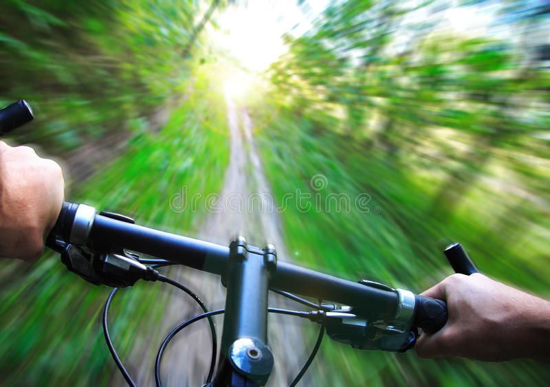 Speed on Mountain bike. Mountain bike speed zoom motion blur. Fast downhill biking stock image
