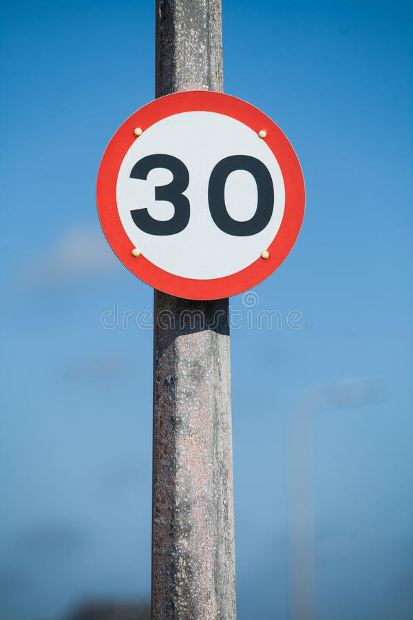 Speed restriction road sign. Color image of a 30km/h speed restriction road sign stock photo