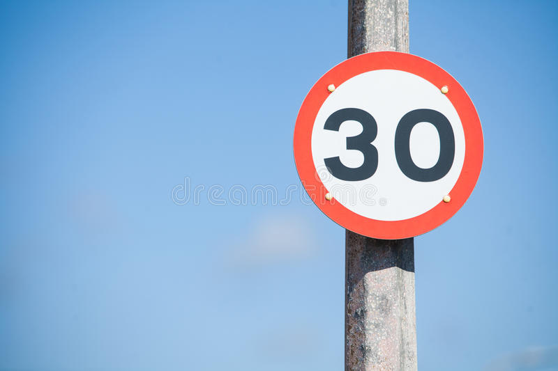 Speed restriction road sign. Color image of a 30km/h speed restriction road sign royalty free stock photo