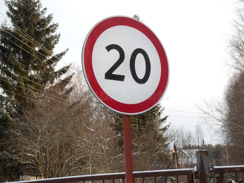 Speed restriction road sign. Speed restriction of 20km/h road sign stock photos