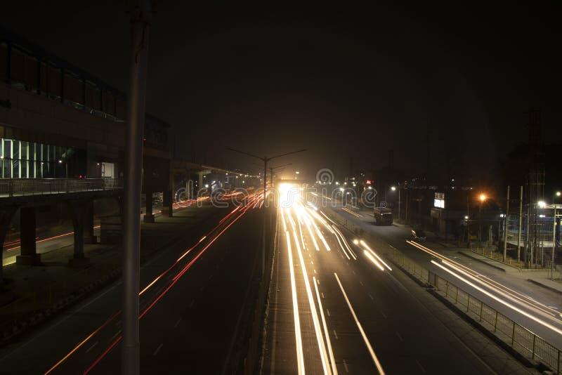 Speed Traffic light trails on highway, long exposure, urban background and dark sky. Speed Traffic light trails on highway royalty free stock photos