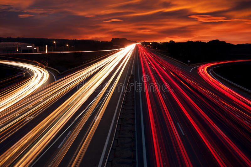 Speed Traffic - light trails on motorway highway at night. Long exposure abstract urban background