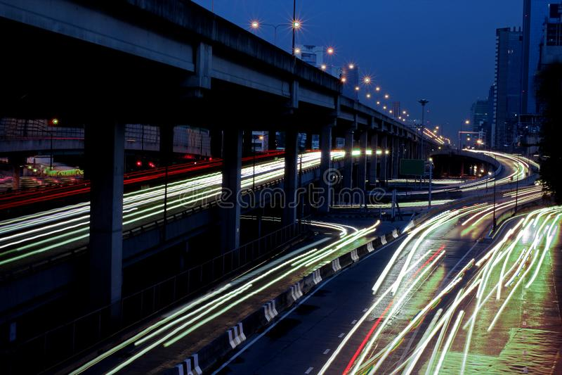 Speed Traffic - light trails on the road at night. Long exposure royalty free stock image