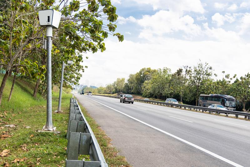 Speed trap surveillance camera along highway to control speeding royalty free stock photos