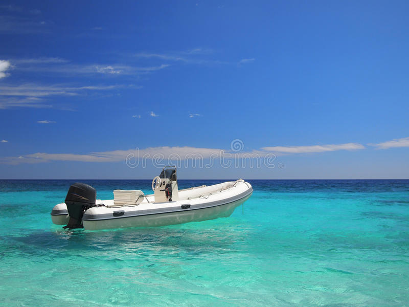 Speedboat in an emerald sea stock photos
