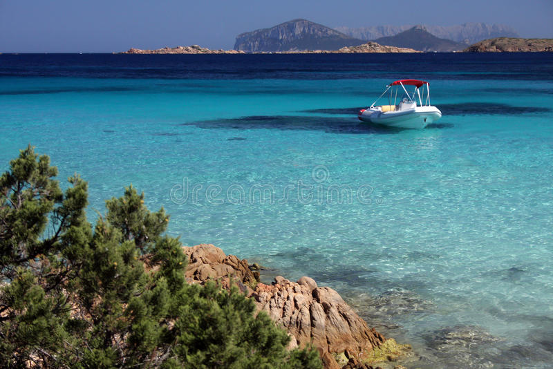 Speedboat in an emerald sea stock photography