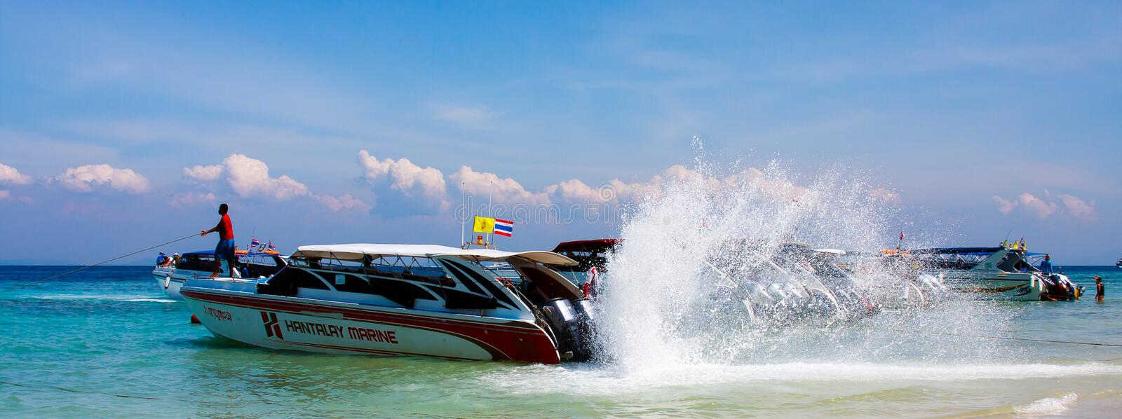 The speedboat, on the waterfront, cleans the propeller. royalty free stock images