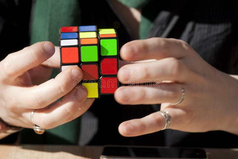 Speedcuber in action with Rubik's cube. Speedsolving a Rubik's Cube. The Rubik's Cube was invented in 1974 by Hungarian professor of architecture Erno Rubik stock image