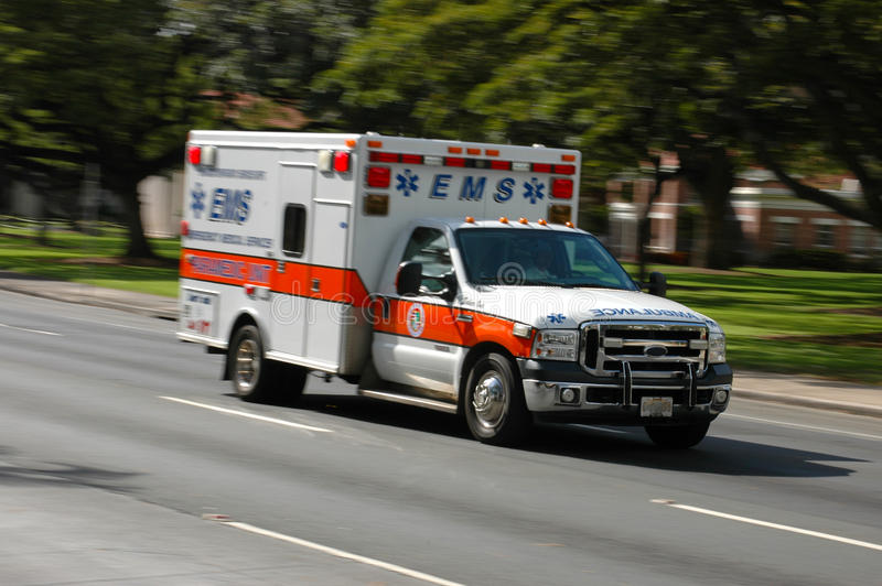 Speeding ambulance. A speeding emergency medical services ambulance, with motion blur stock photos