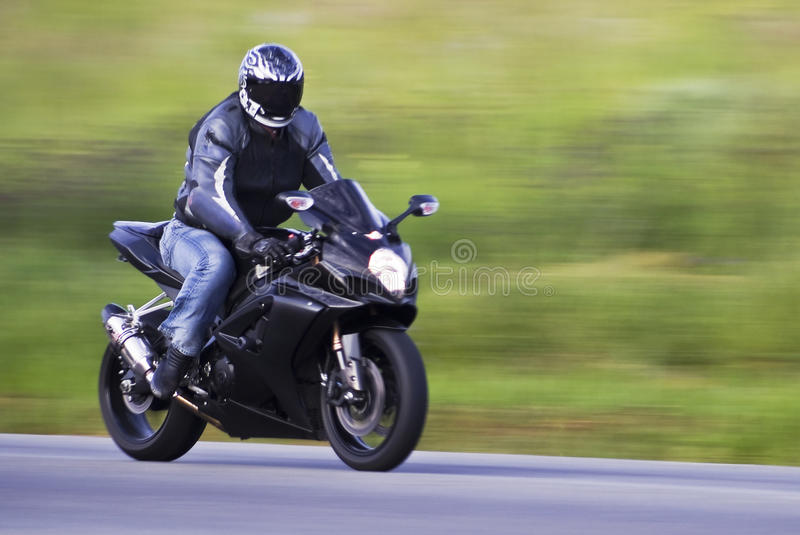 Speeding Biker stock photos
