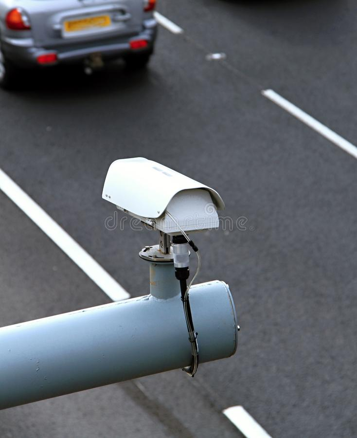 Speeding cameras overlooking the motorway royalty free stock image