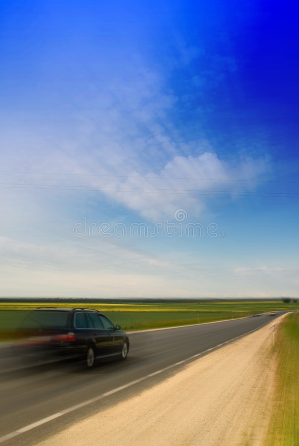 Speeding car. Driving along the highway stock images
