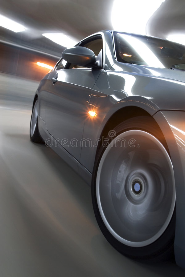 Speeding car with ligh trails royalty free stock photo