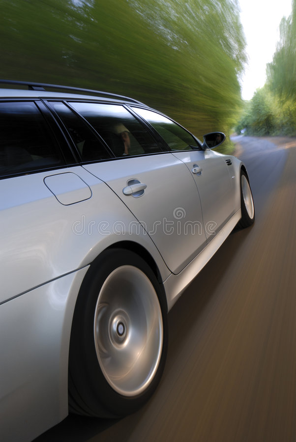 Speeding car with ligh trails stock photos