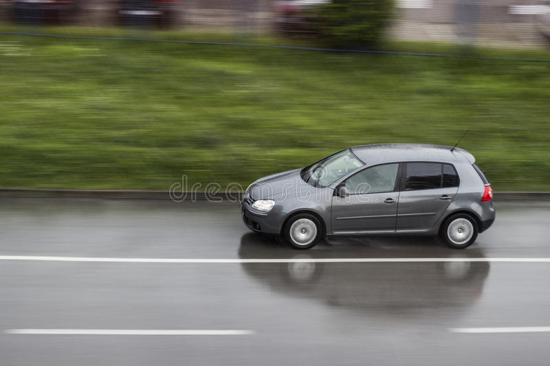 Speeding car. With motion blur in background royalty free stock photography