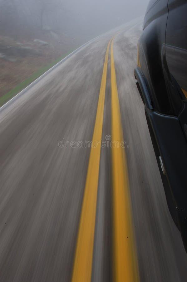 Speeding car road blur stock photo