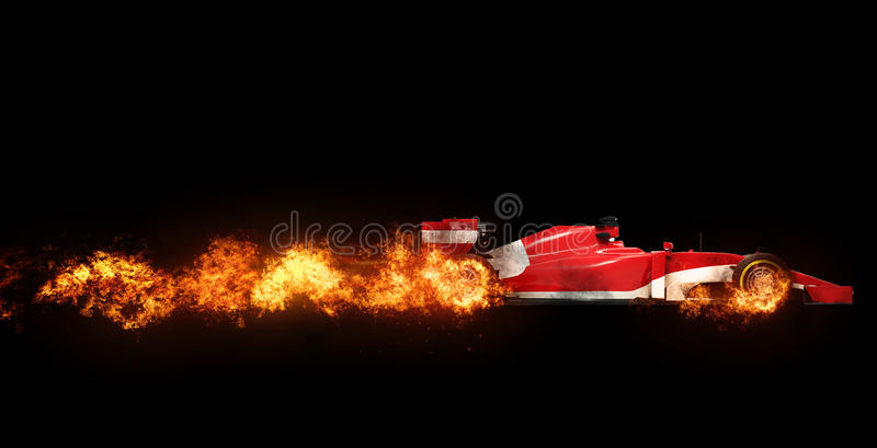 Speeding Formula one car - wheels on fire. On black background stock photos