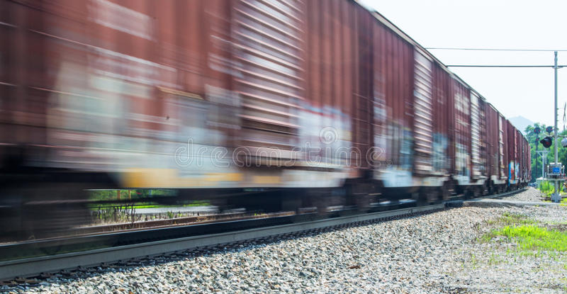 Speeding Freight Train. Going through a railroad crossing stock image