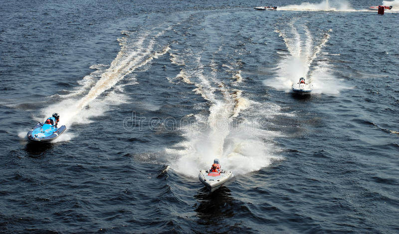 Speeding motorboats stock images