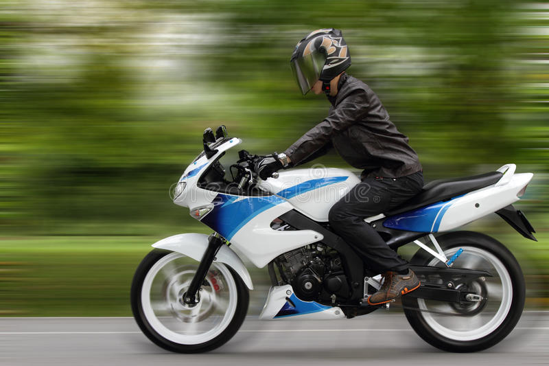 Speeding Motorcyclist Royalty Free Stock Image