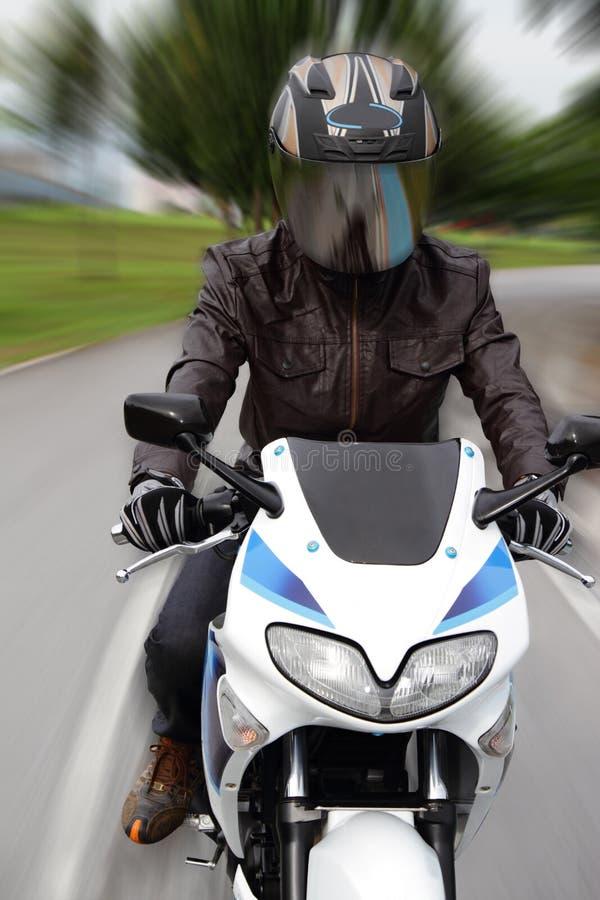 Speeding Motorcyclist Stock Photography