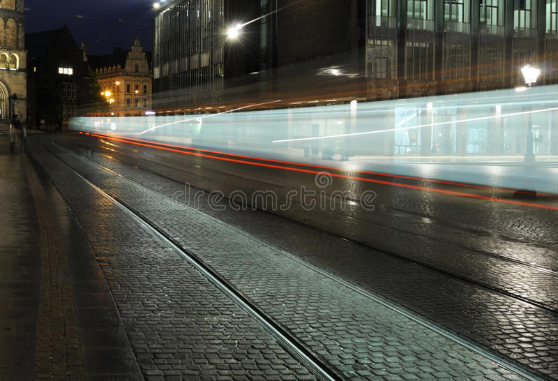 Speeding night tram stock photo