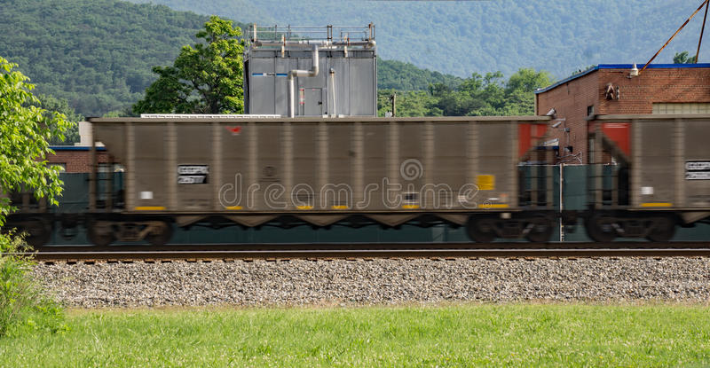Speeding Railroad Cars. A speeding train with railroad cars going through a railroad crossing located in Salem, Virginia, USA royalty free stock images