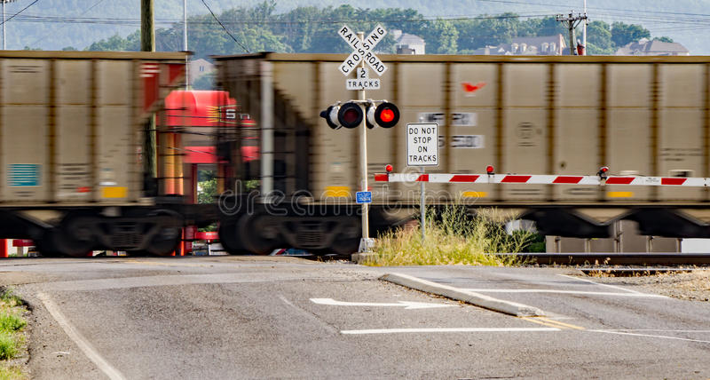Speeding Railroad Cars. A speeding train with railroad cars going through a railroad crossing located in Salem, Virginia, USA stock photography