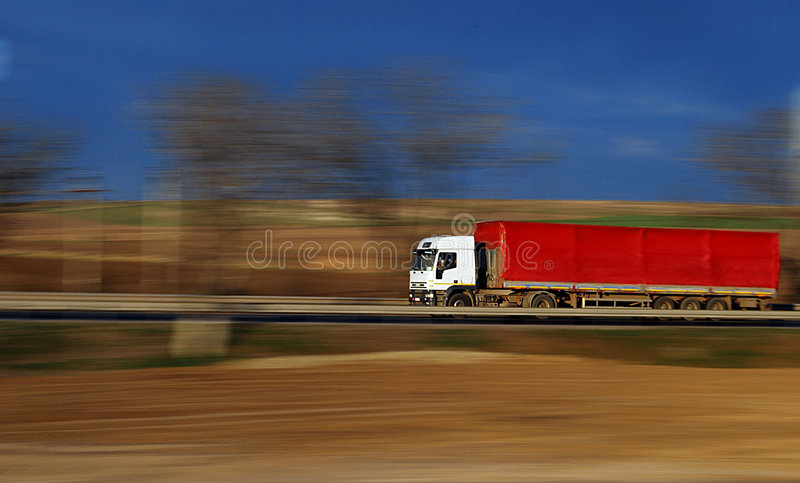 Speeding Red Truck royalty free stock image