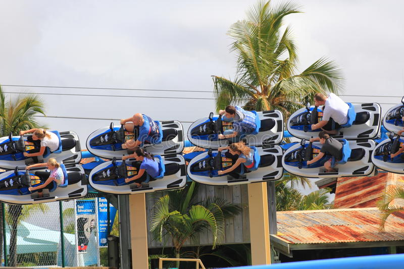 Speeding roller coaster ride in banked turn stock photography