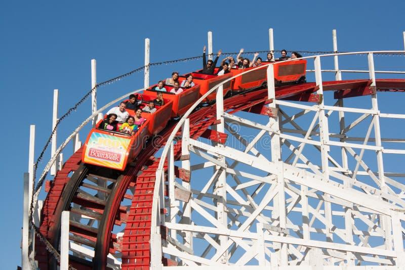 Speeding roller coaster royalty free stock photography