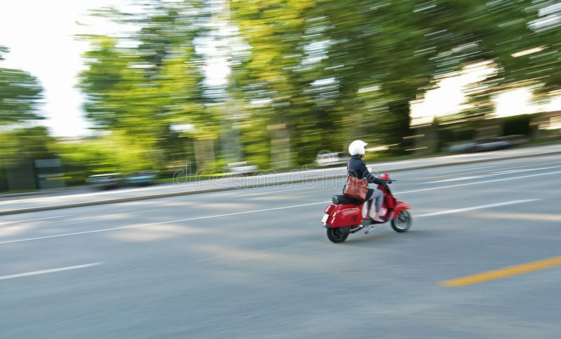 Speeding scooter. A panning image of a speeding scooter stock photography