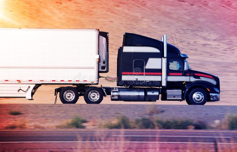 Speeding Semi Truck. On a Highway. Heavy Duty Road Transportation Concept stock photography