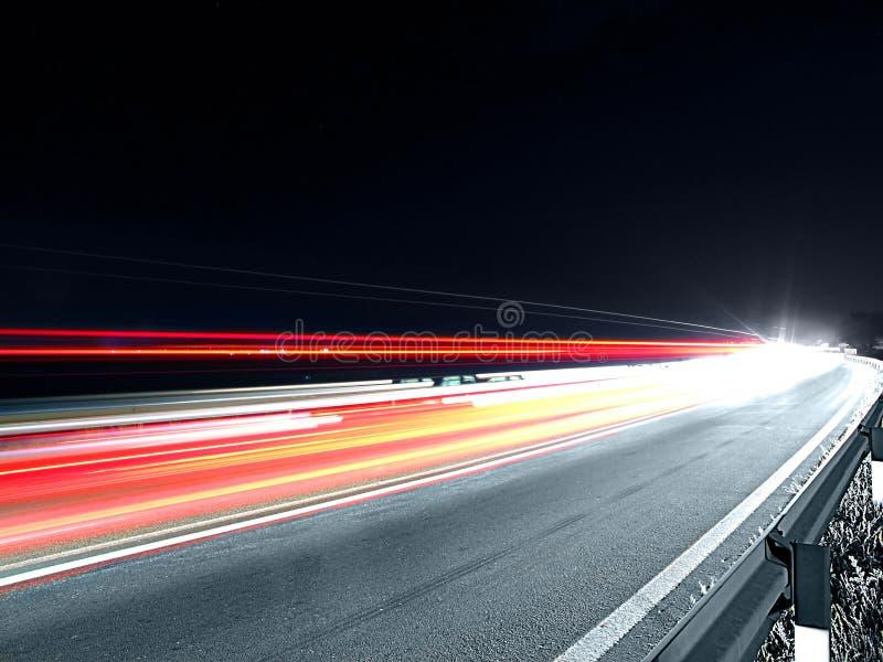 Speeding traffic at night stock photography