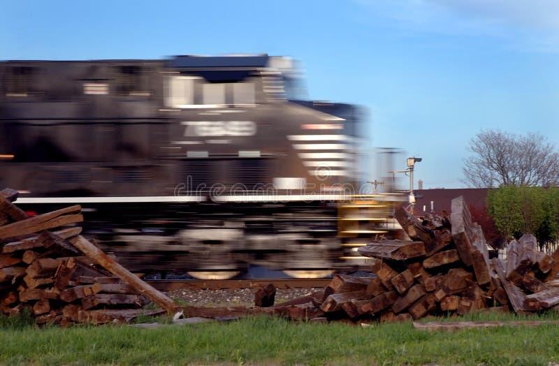 Download Speeding train stock image. Image of logs, tracks, home - 2393515