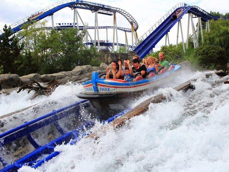 Speeding water roller coaster family fun stock images