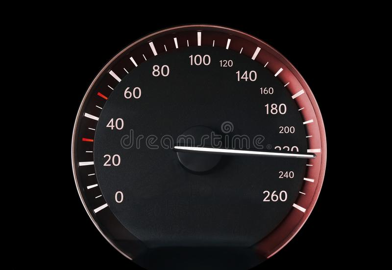 Speedometer of a car. Showing 220, glowing with red light stock image