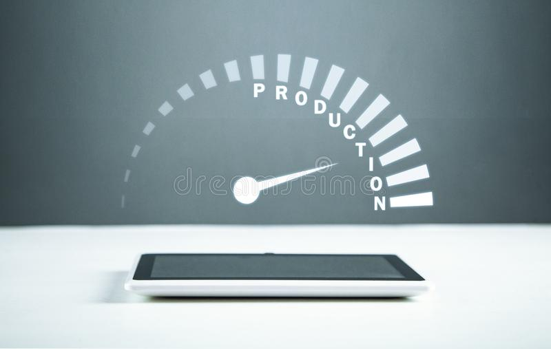 Speedometer with Production word on tablet. Business concept stock photos