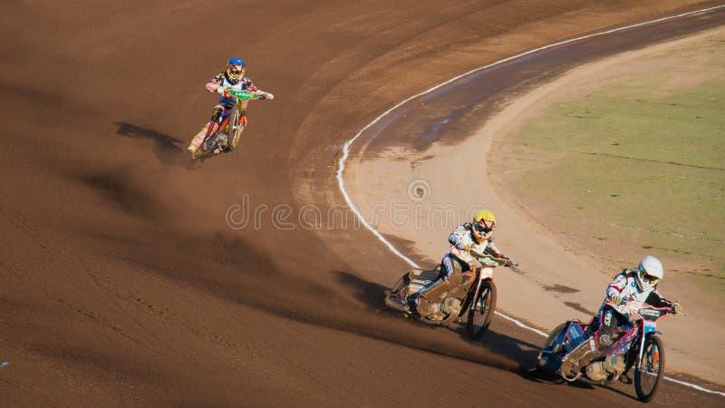 Speedwaybaanruiters het in het nauw drijven stock afbeeldingen