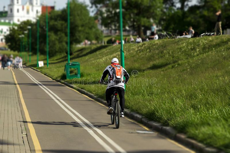 Speedy shadow - A cyclist at top speed on the triathlon race stock photo