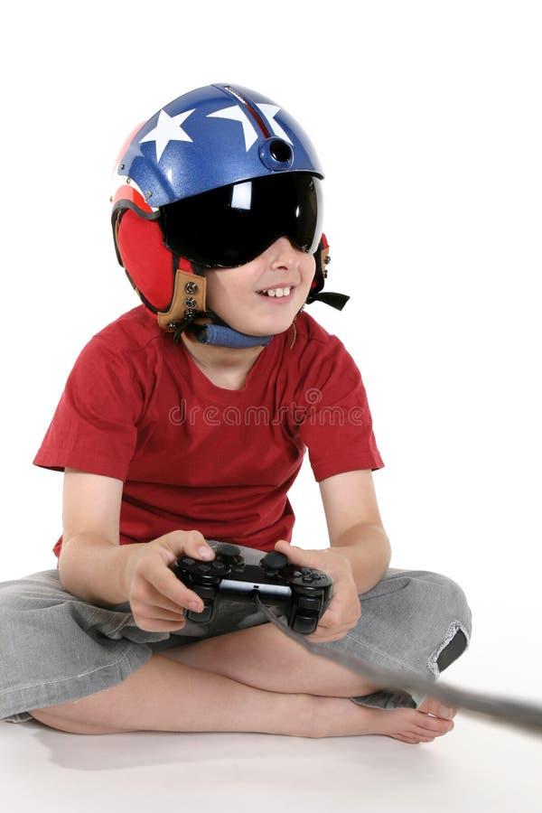 Speel de computerspelen van het kind stock afbeeldingen