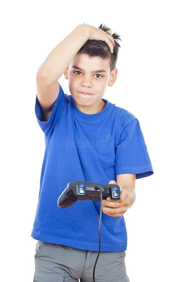 Speel de computerspelen van het kind op de bedieningshendel stock afbeelding