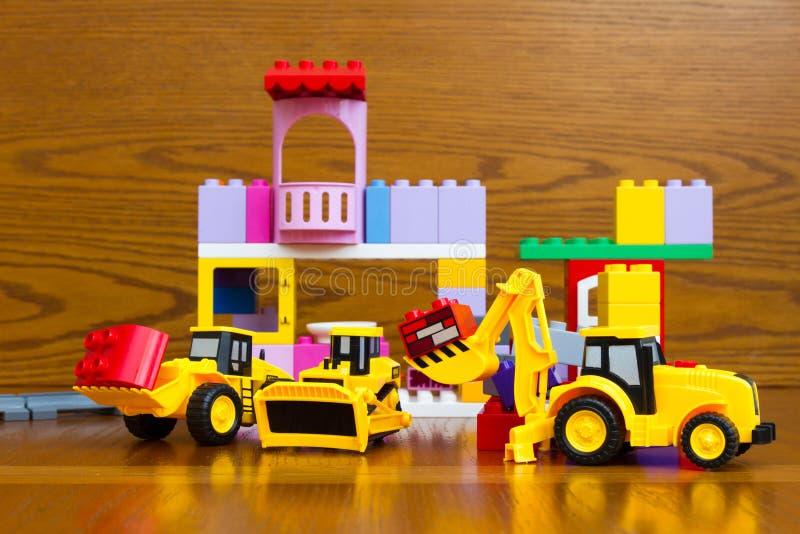 Speelgoed voor de jongen Bulldozer, tractor stock afbeelding