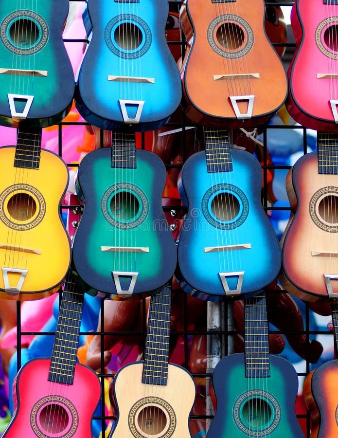Speelgoedgitaren stock foto's
