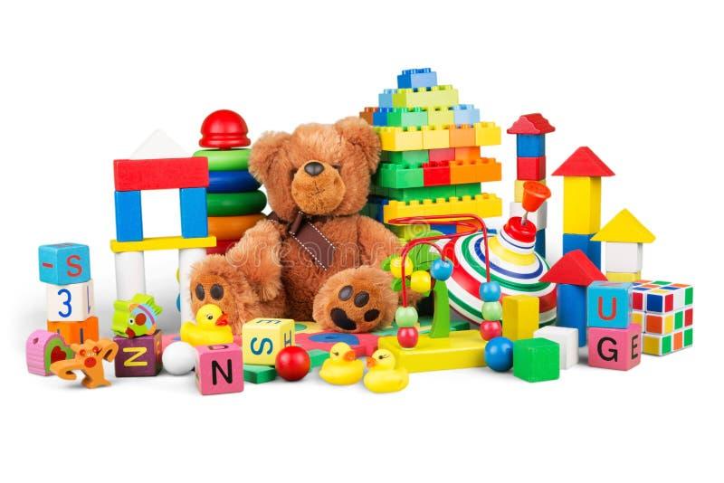 Speelgoedinzameling op witte achtergrond wordt geïsoleerd die stock fotografie