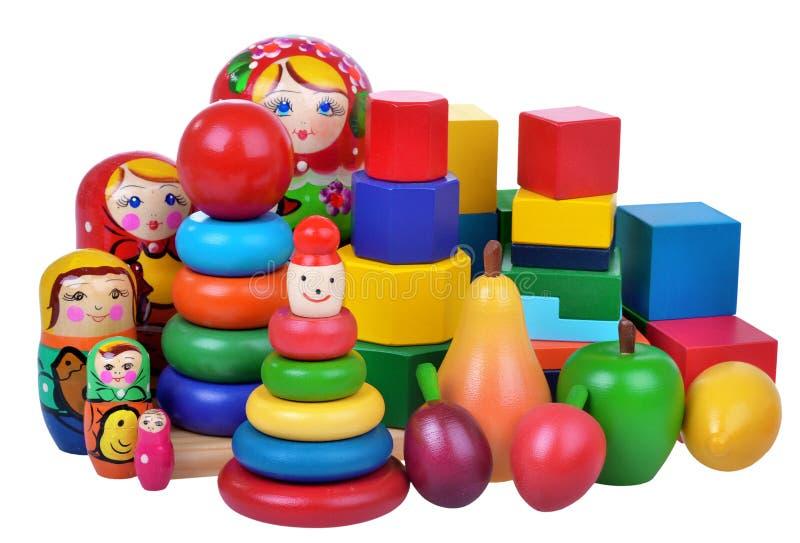 Speelgoedinzameling op witte achtergrond wordt geïsoleerd die stock foto