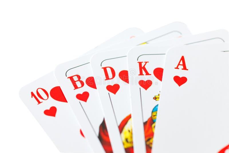 Speelkaarten op wit stock foto