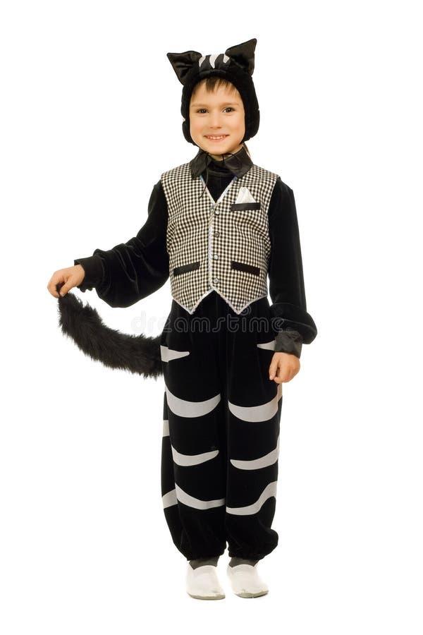 Speelse jongen bij kostuumkat stock foto